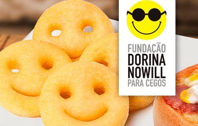 Descrição de imagem: fotografia de batatas Smile e o logo da Fundação Dorina. Fim da descrição.